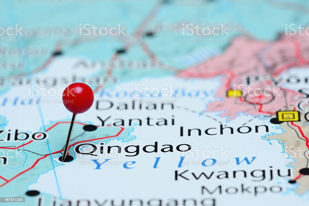 Qingdao pinned on a map of Asia stock photo