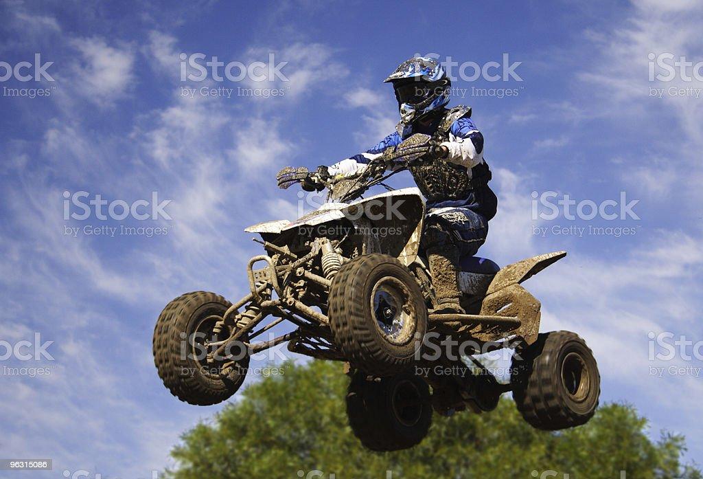 quad bike jump stock photo