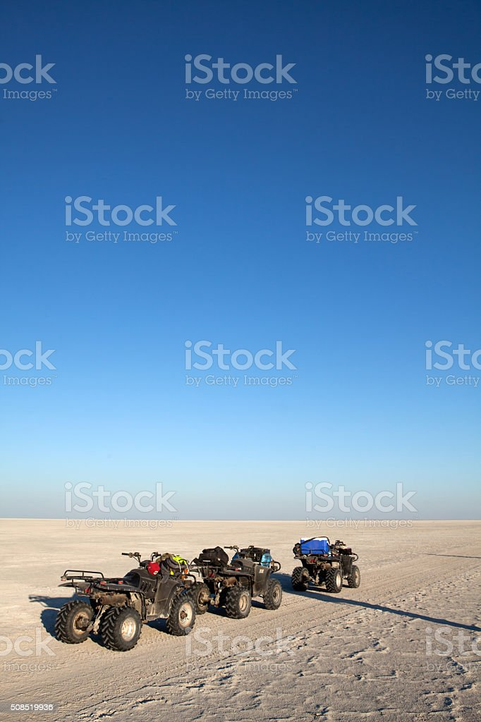 Quad Bikes on salt flat stock photo
