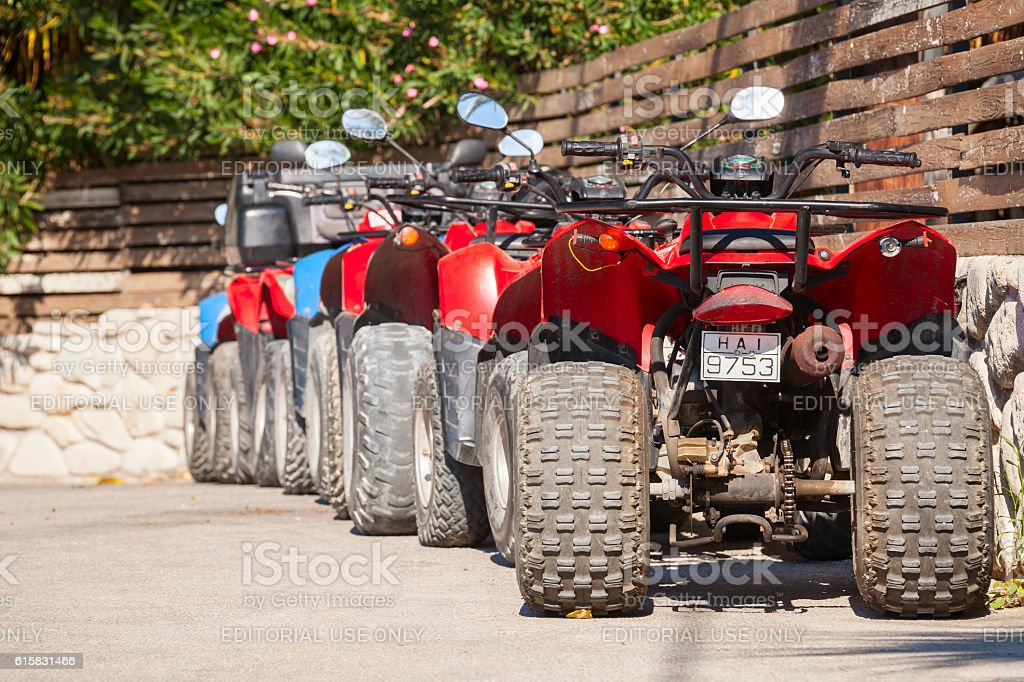 ATV quad bikes stand parked in a row stock photo