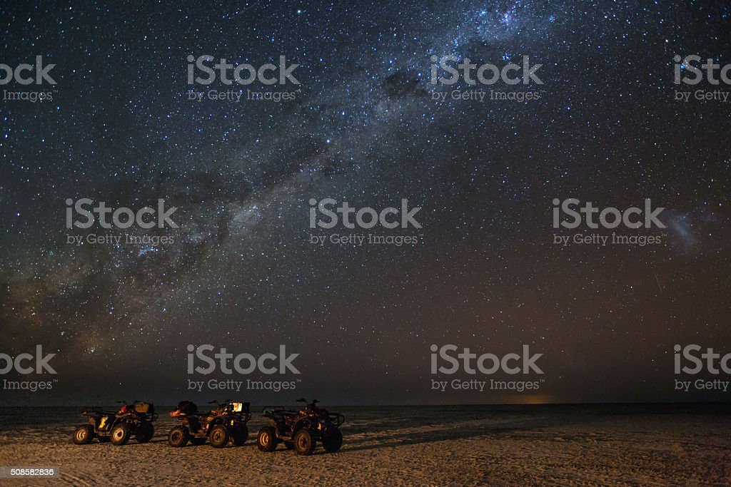 Quad bikes under a gallaxy stock photo