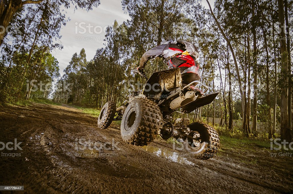 Quad rider jumping stock photo