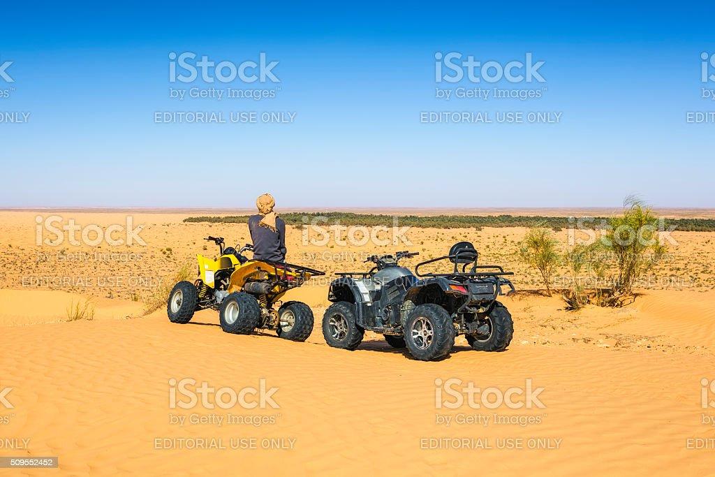 Quad Trip in Sahara desert near Ksar Ghilane oasis , Tunisia stock photo