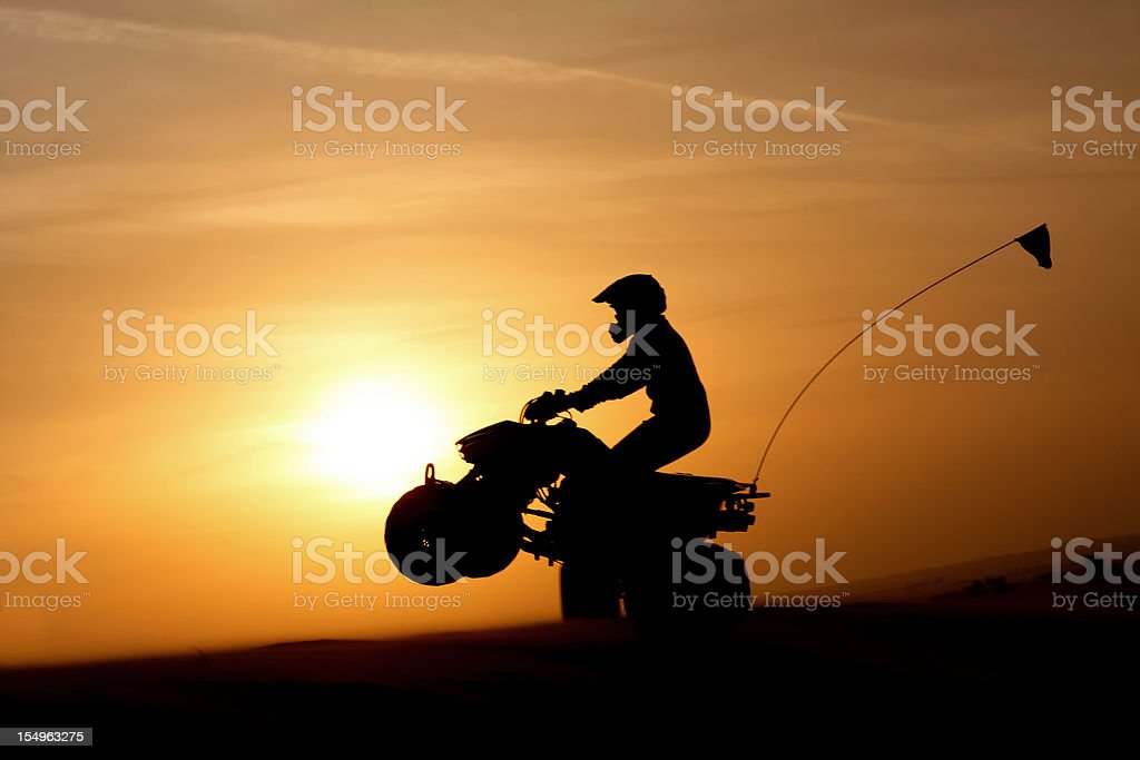 Quadbike at sunset stock photo
