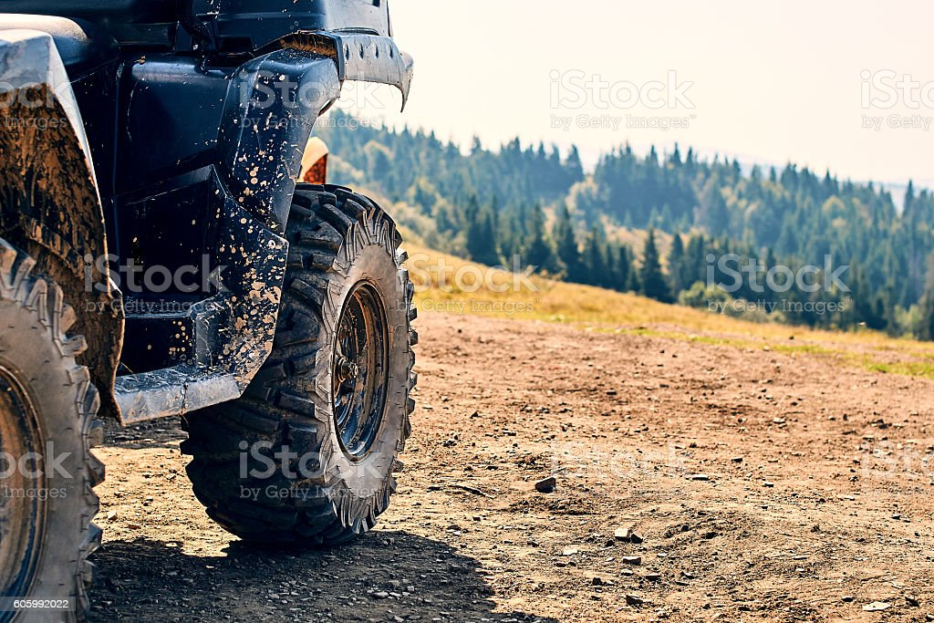 Quadbike in the mountains stock photo