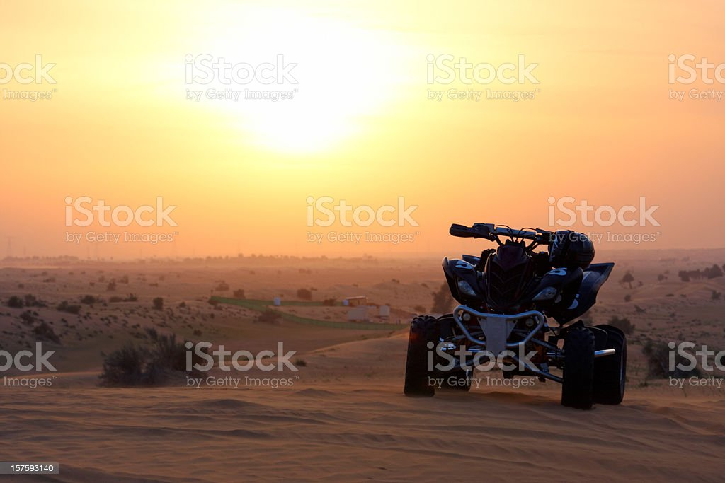 Quadbike in the sunset stock photo