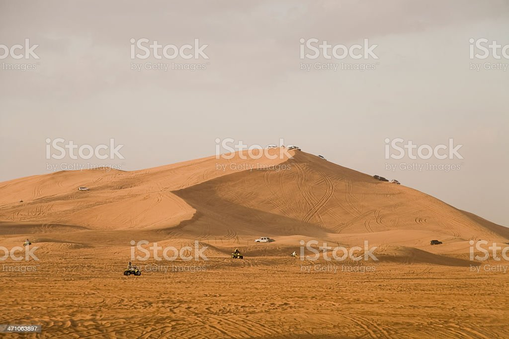 Quadbike Racing on Desert Dunes United Arab Emirates stock photo