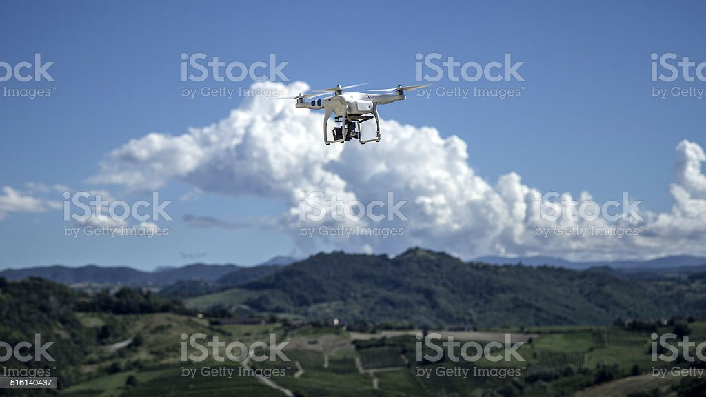 Quadcopter drone flying high stock photo