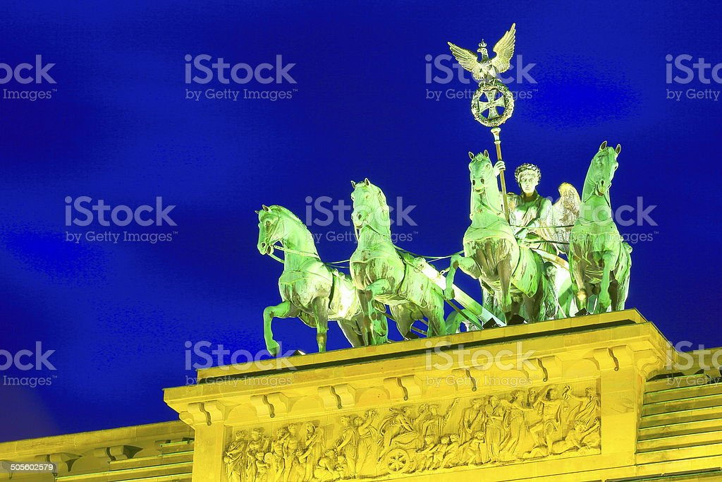 Quadriga Statue illuminated at night, Brandenburg gate, Berlin stock photo