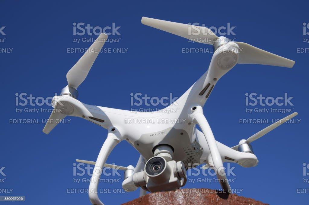 Quadrocopter DJI Phantom 4 against the blue sky. stock photo