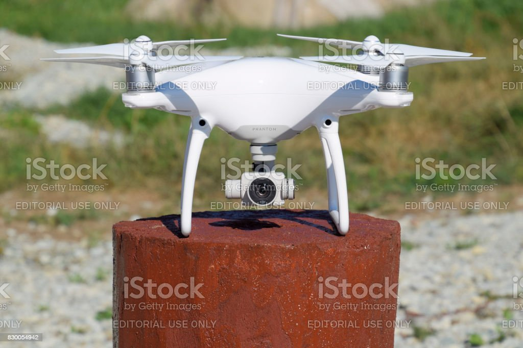 Quadrocopter DJI Phantom 4 on a wooden hemp. Preparing the drone for the flight. Dron is an innovative flying robot. stock photo