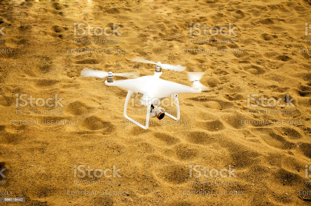 quadrocopter drone on the sand ready for flight stock photo