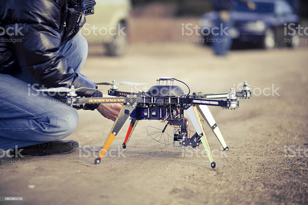 Quadrocopter drone ready to takeoff stock photo