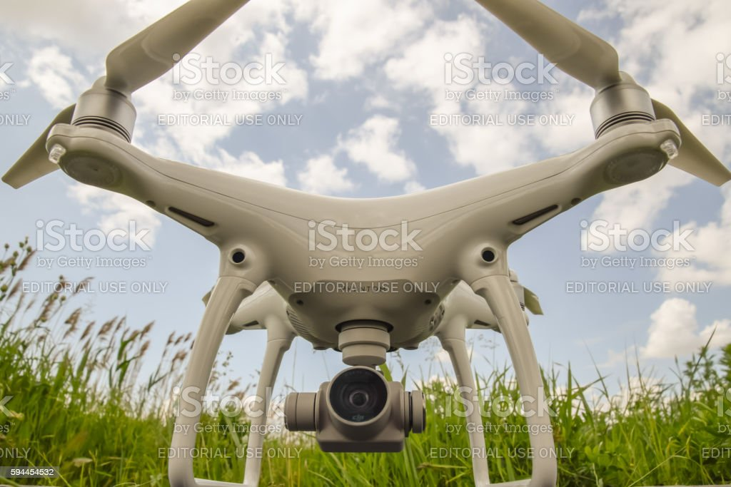Quadrocopters on a plastic box in the grass stock photo