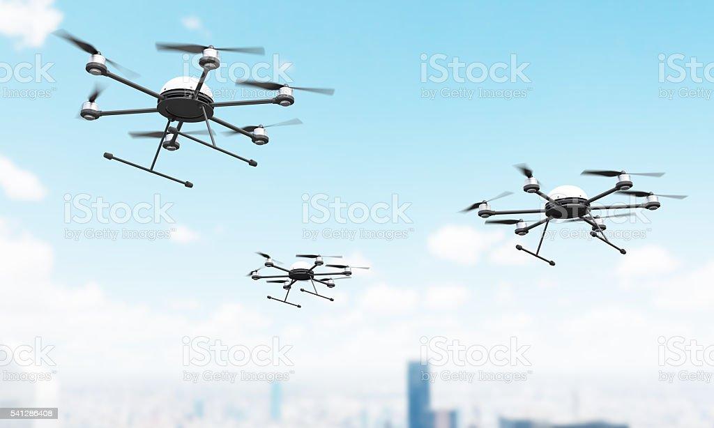Quadrocopters over city stock photo