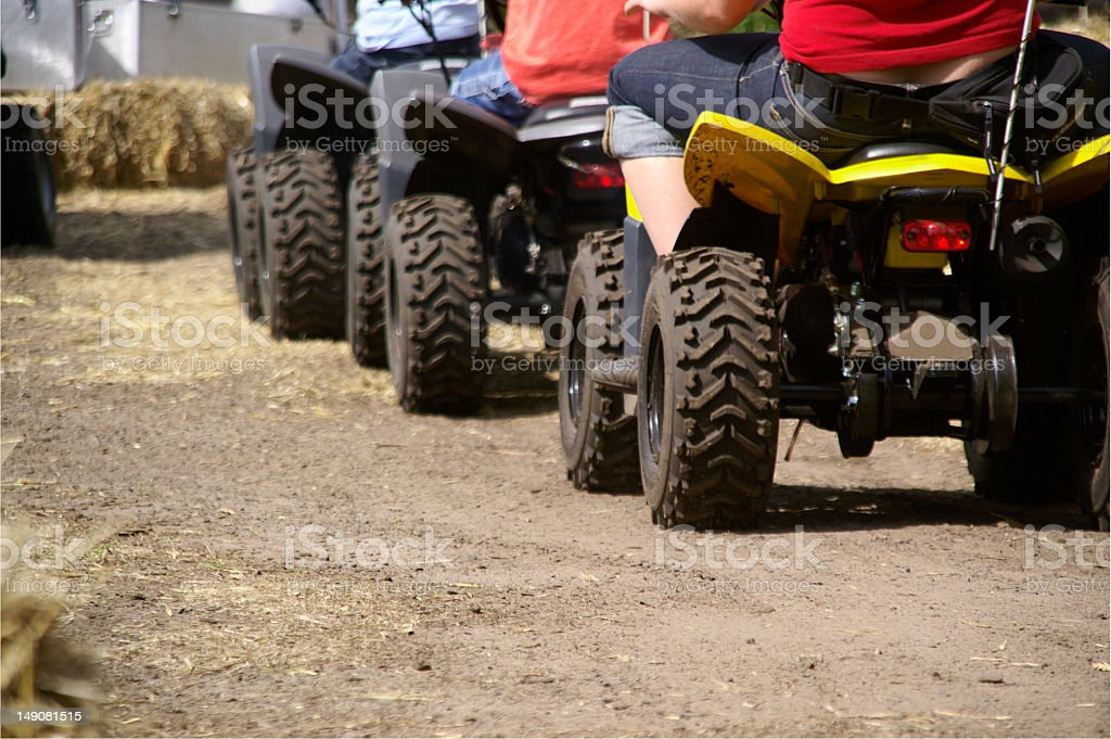 quads in a row stock photo
