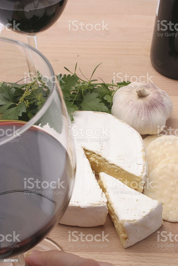 Quaffing Red wine and brie cheese royalty-free stock photo