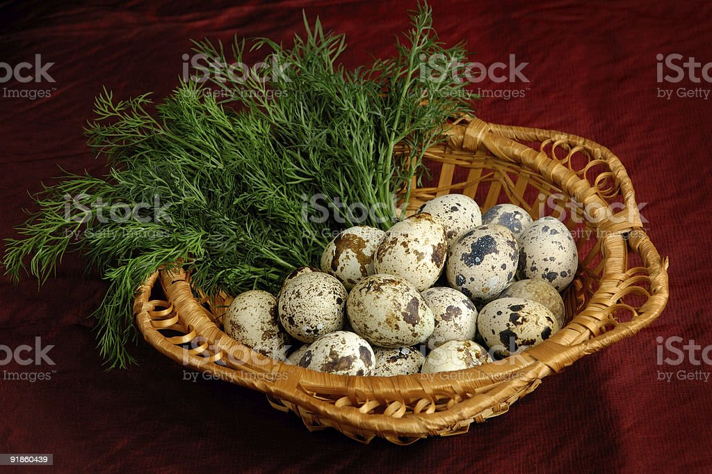 Quail eggs and greens in basket healthy  food royalty-free stock photo