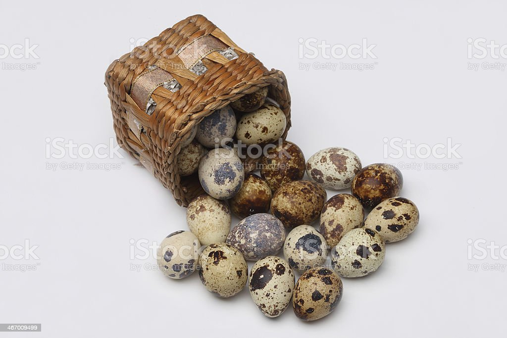 Quail eggs in basket royalty-free stock photo