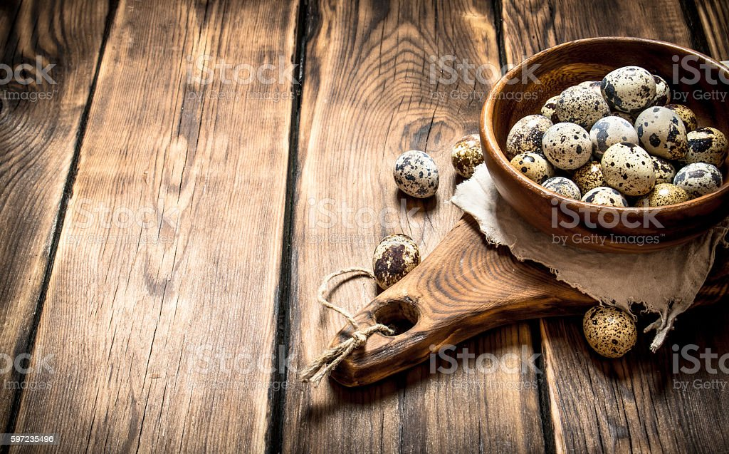 Quail eggs in bowl on the Board. stock photo