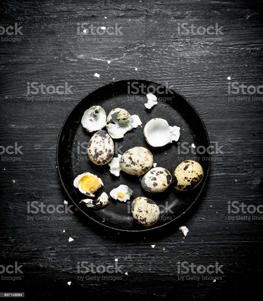 Quail eggs in the old plate. stock photo