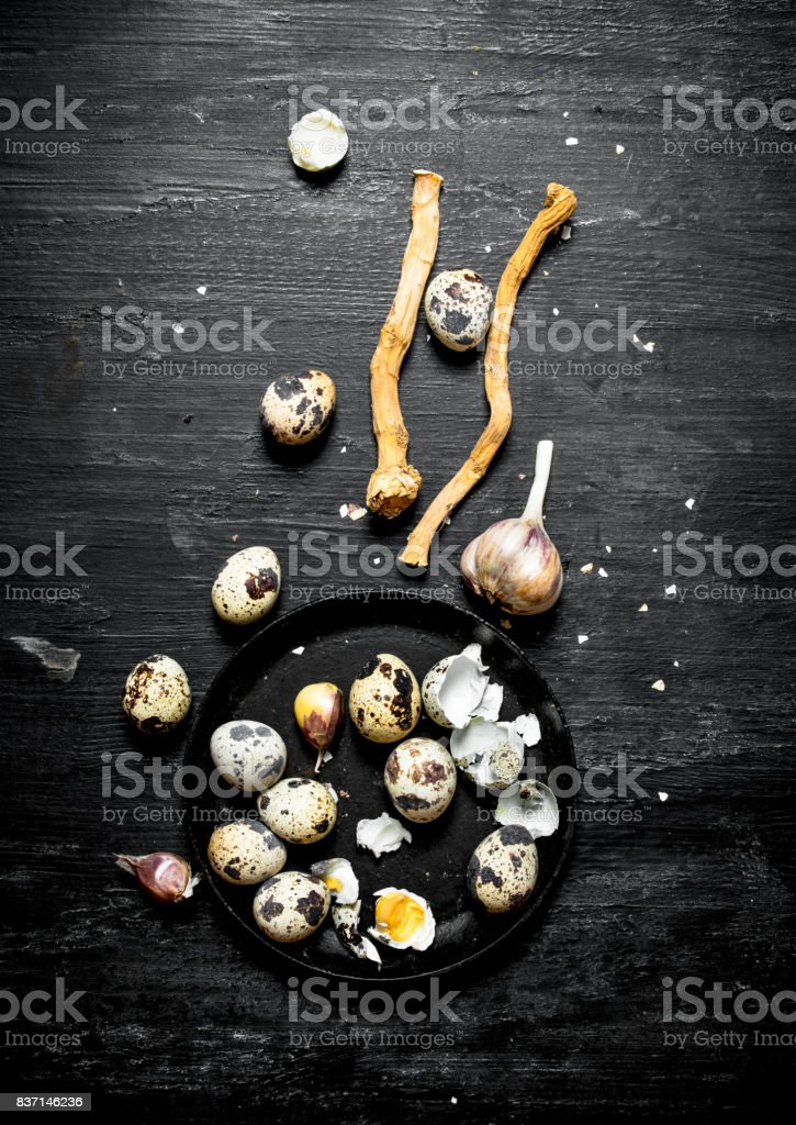 Quail eggs with garlic and salt. stock photo