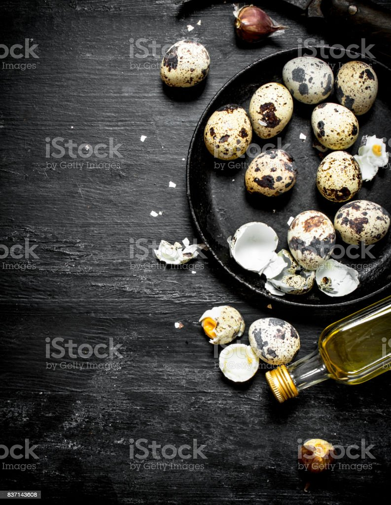 Quail eggs with olive oil and garlic. stock photo