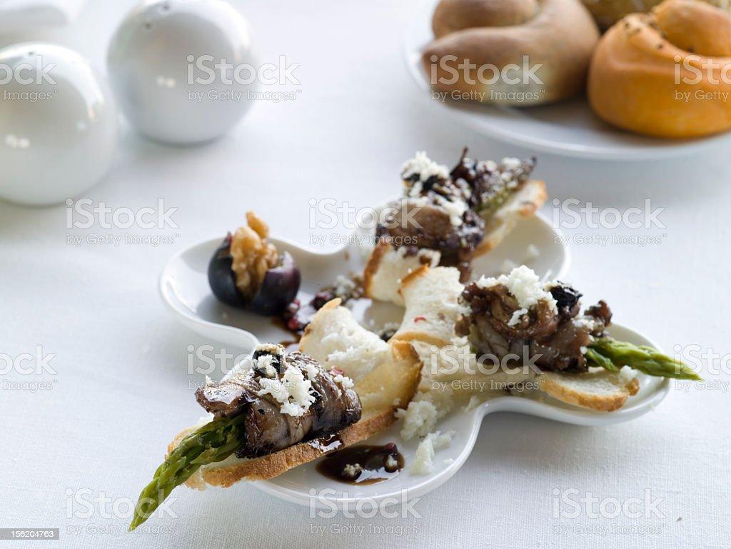 Quail  rolls with asparagus stock photo
