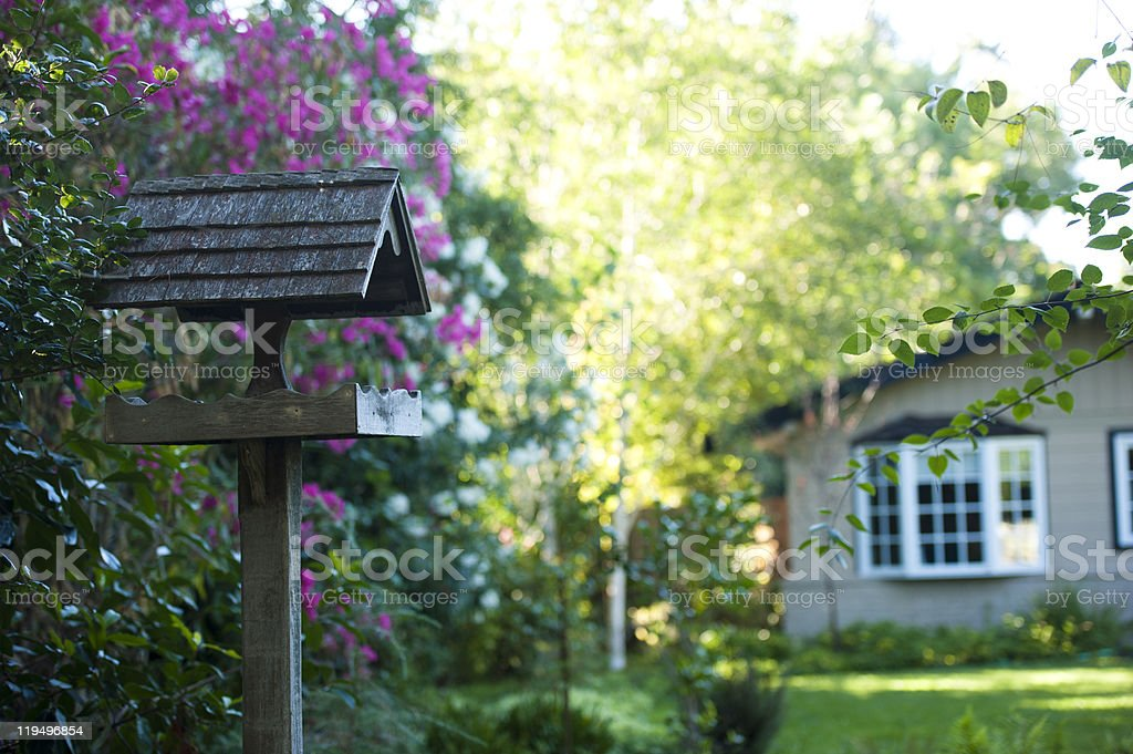 quaint birdhouse in a beautiful garden stock photo