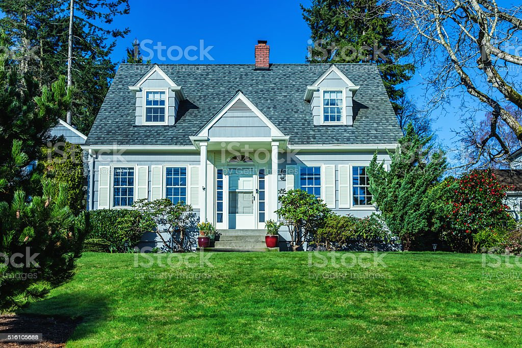 Quaint Cape Cod Style House stock photo