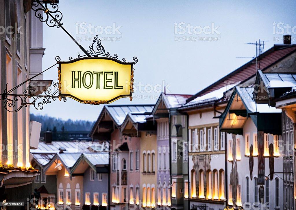 Quaint hotel sign on historical street stock photo
