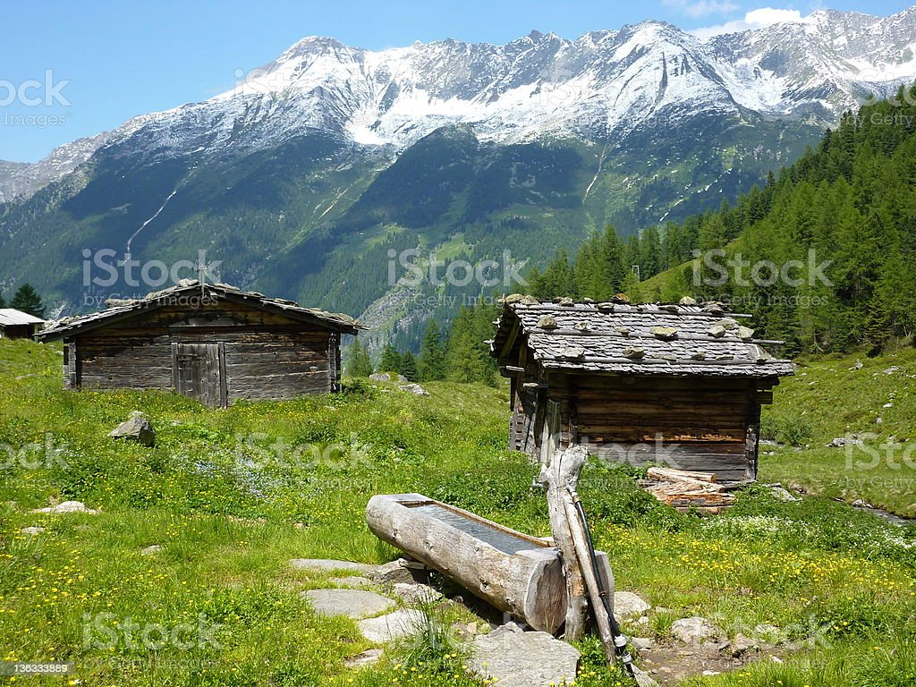 quaint wooden houses in the Alps stock photo