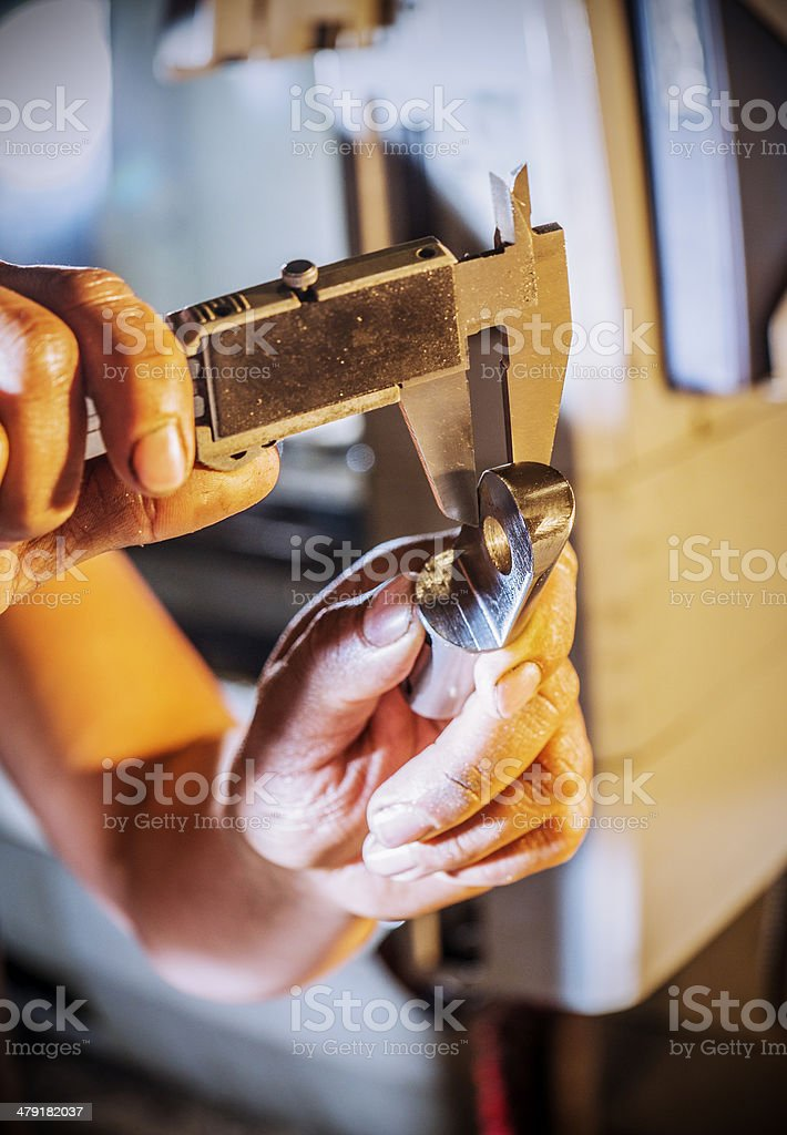 Quality control in a machineshop stock photo