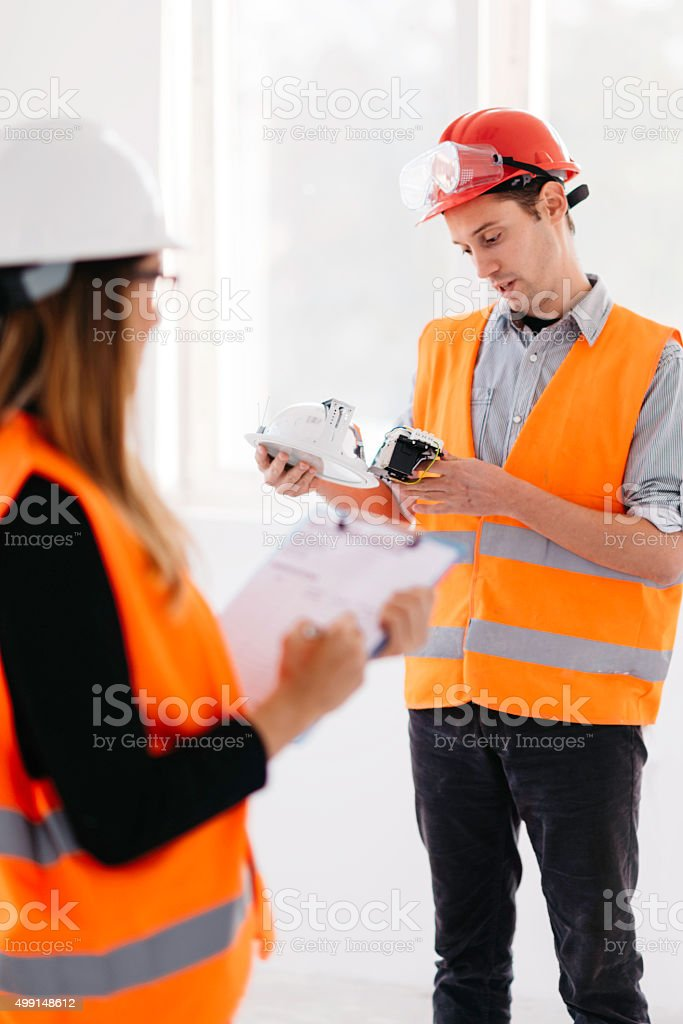 Quality control inspectors checking light fixtures stock photo