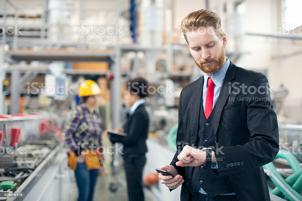Quality inspector checking his watch stock photo
