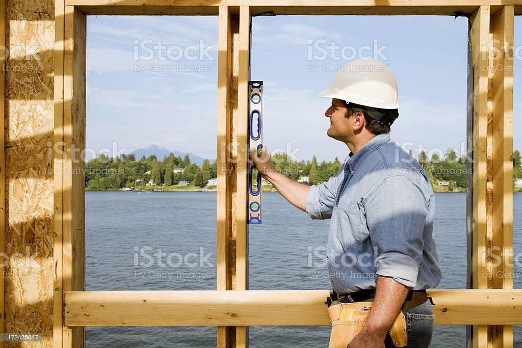 Quality Inspector Checking Level royalty-free stock photo