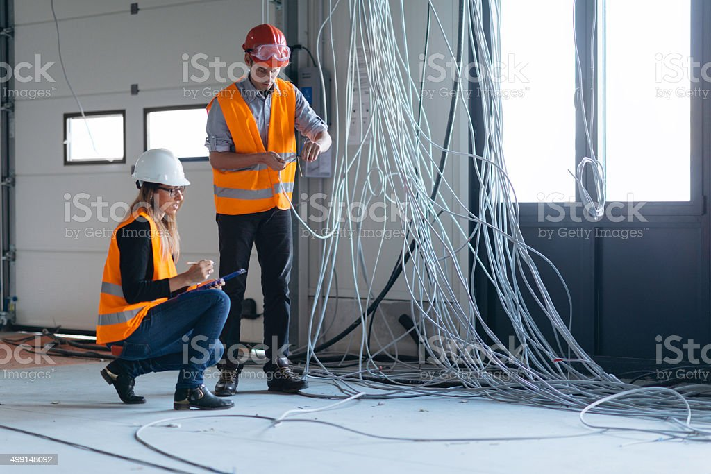 Quality inspectors checking construction progress stock photo