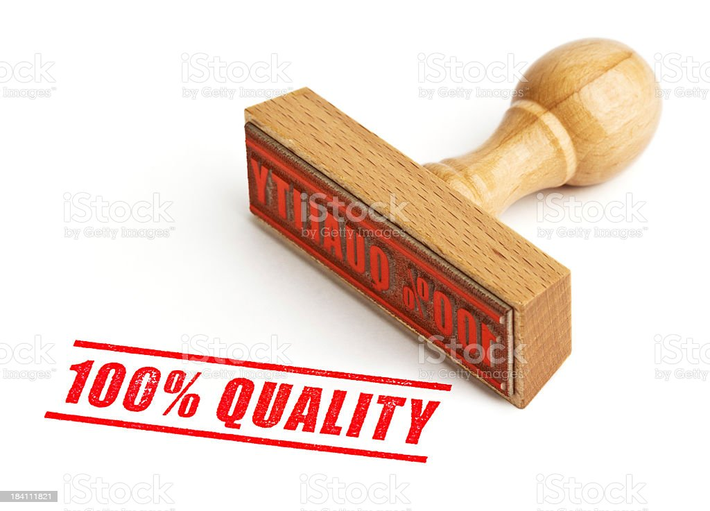 100% quality wooden stamp with red ink on white background stock photo