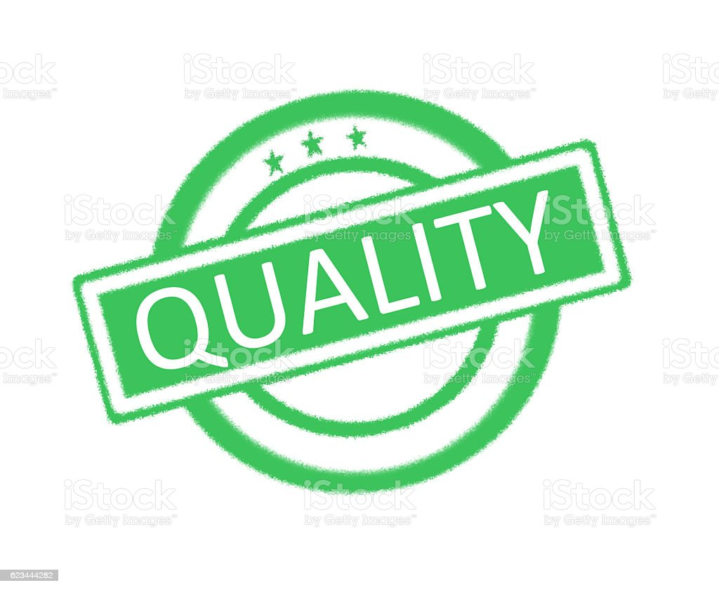Quality written on green rubber stamp stock photo