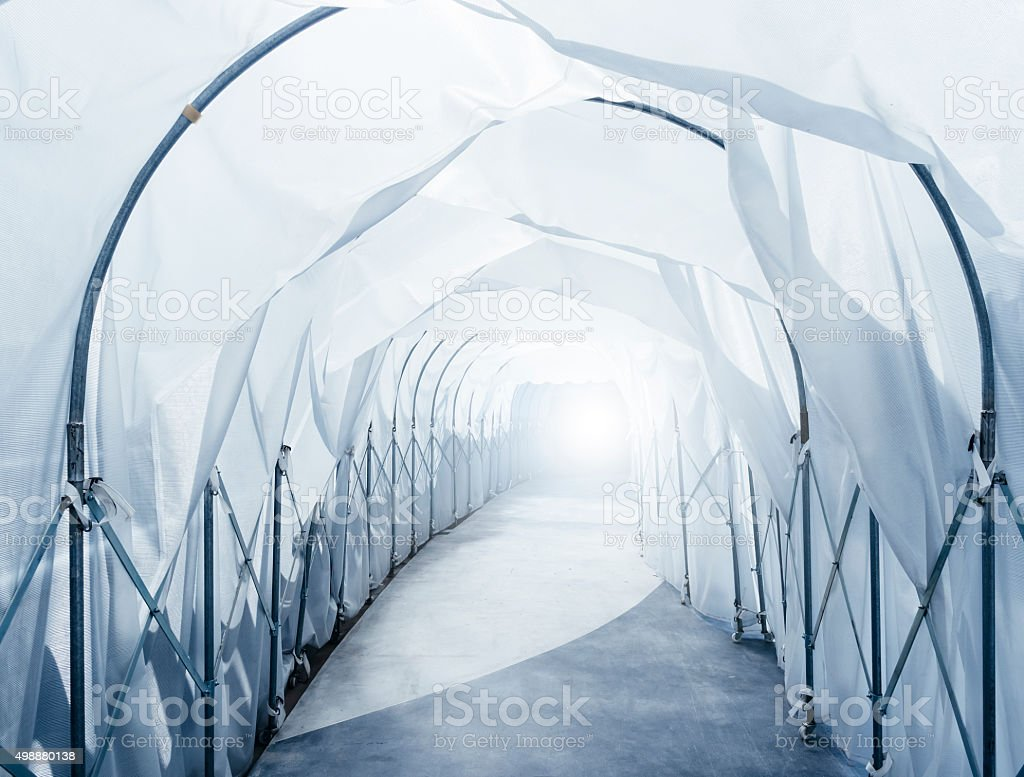 Quarantine Area with retractable Industrial Tunnel walkway stock photo