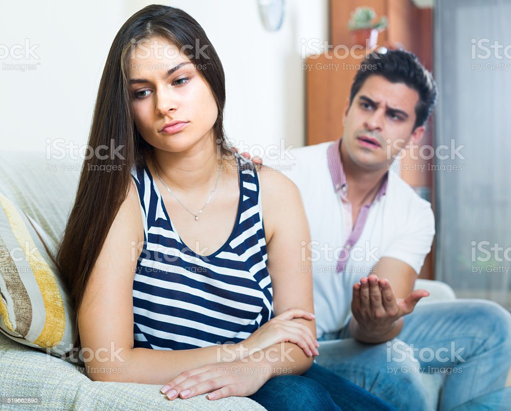 Quarrel between young spouses at home stock photo