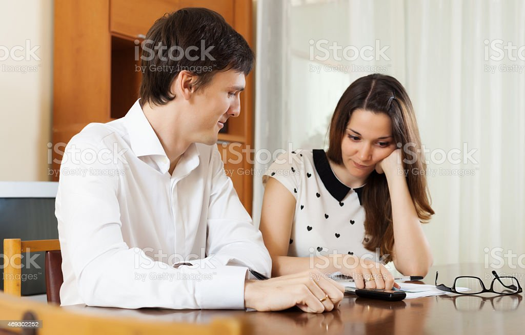 quarrel in young family over  financial documents stock photo