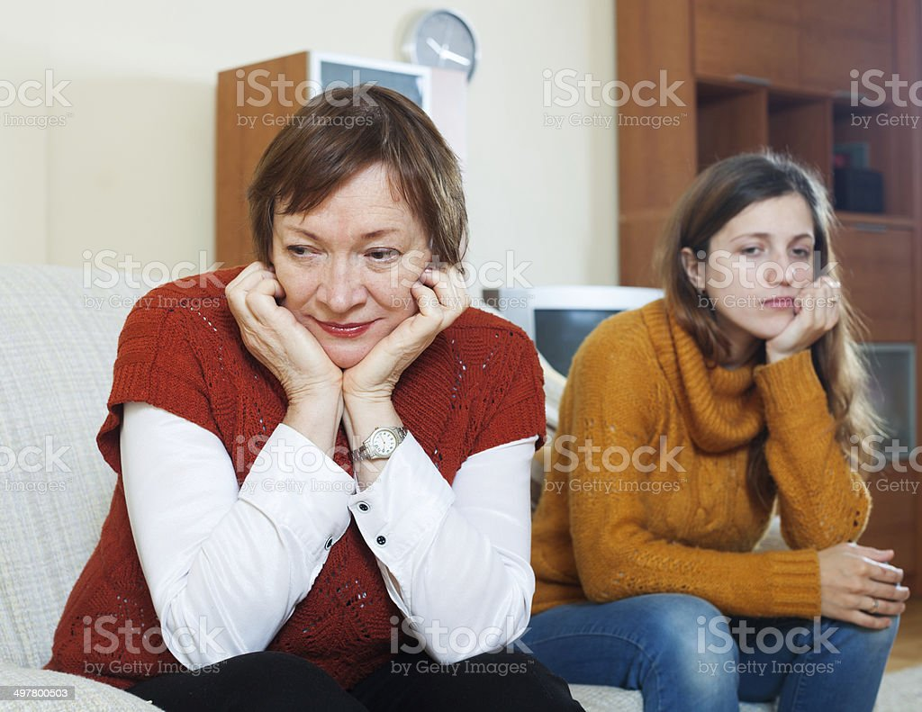 Quarrel of adult daughter and mature mother stock photo
