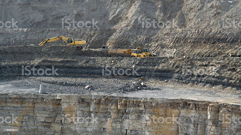 quarry digger and dump trucks stock photo