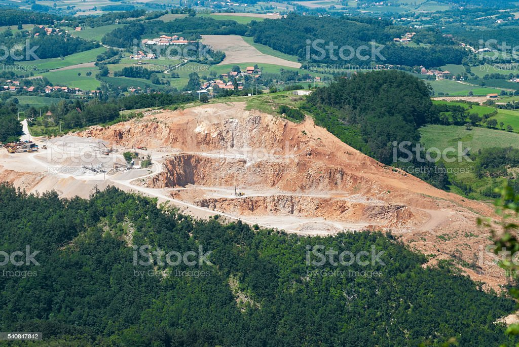 Quarry - open pit in natural countryside stock photo