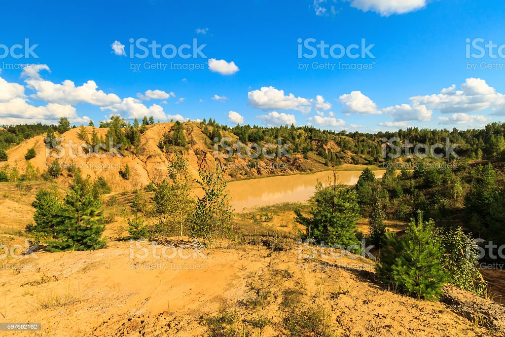 quarry or lake or pond with sandy beach stock photo