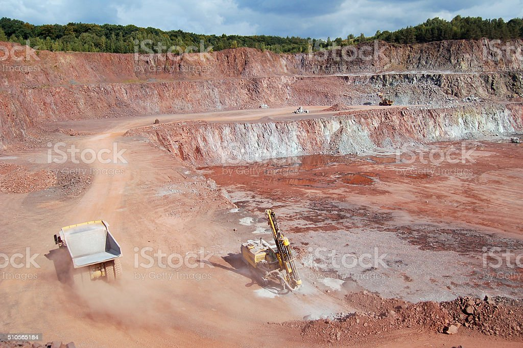 Quarry with dump truck drill and excavator stock photo