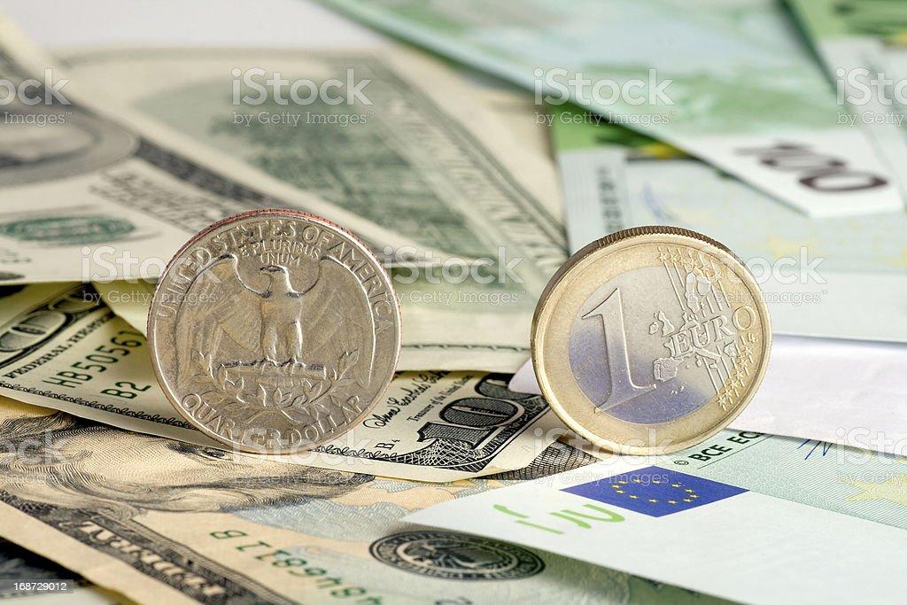 Quarter dollar and euro royalty-free stock photo