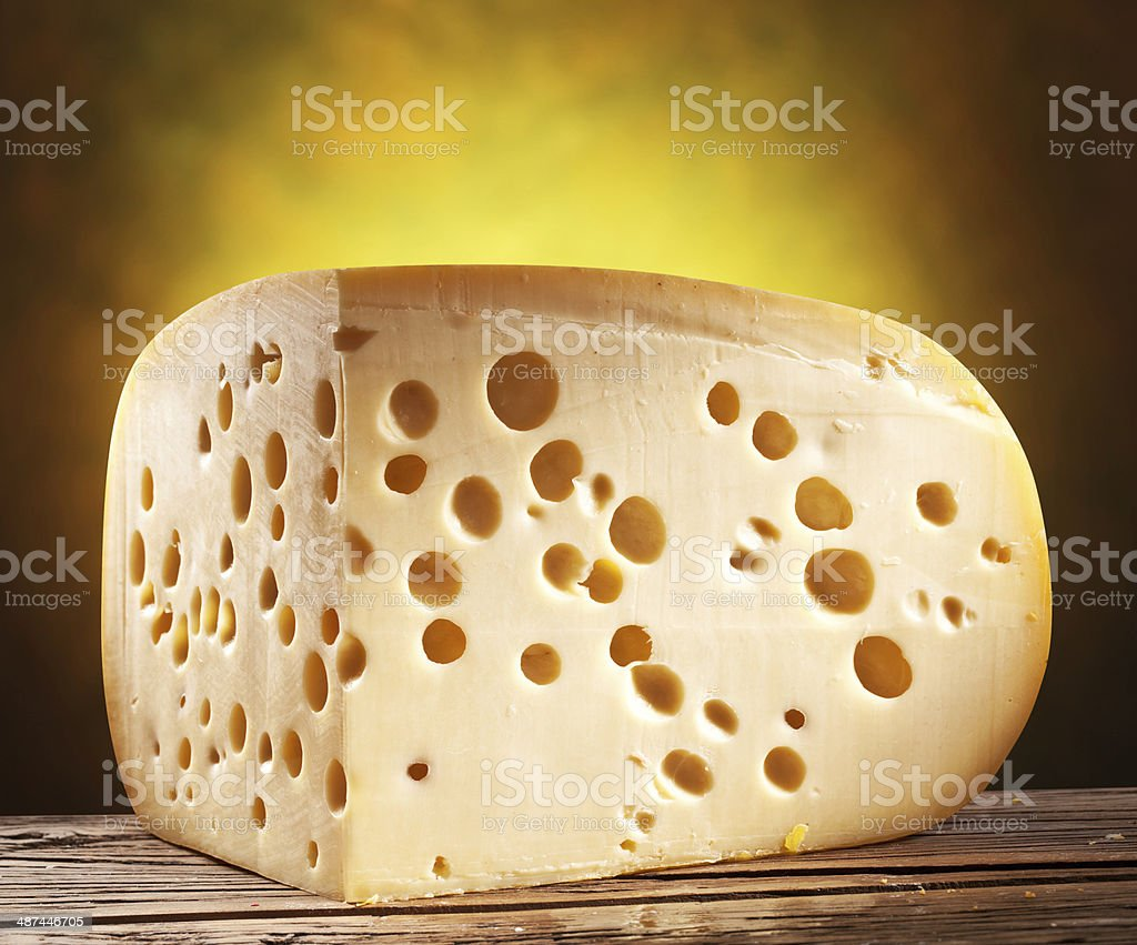 Quarter of Emmental cheese head. stock photo