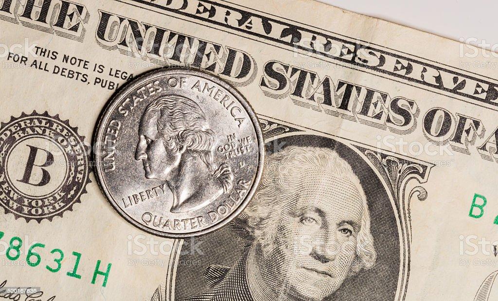 Quarter on US Dollar Bill stock photo